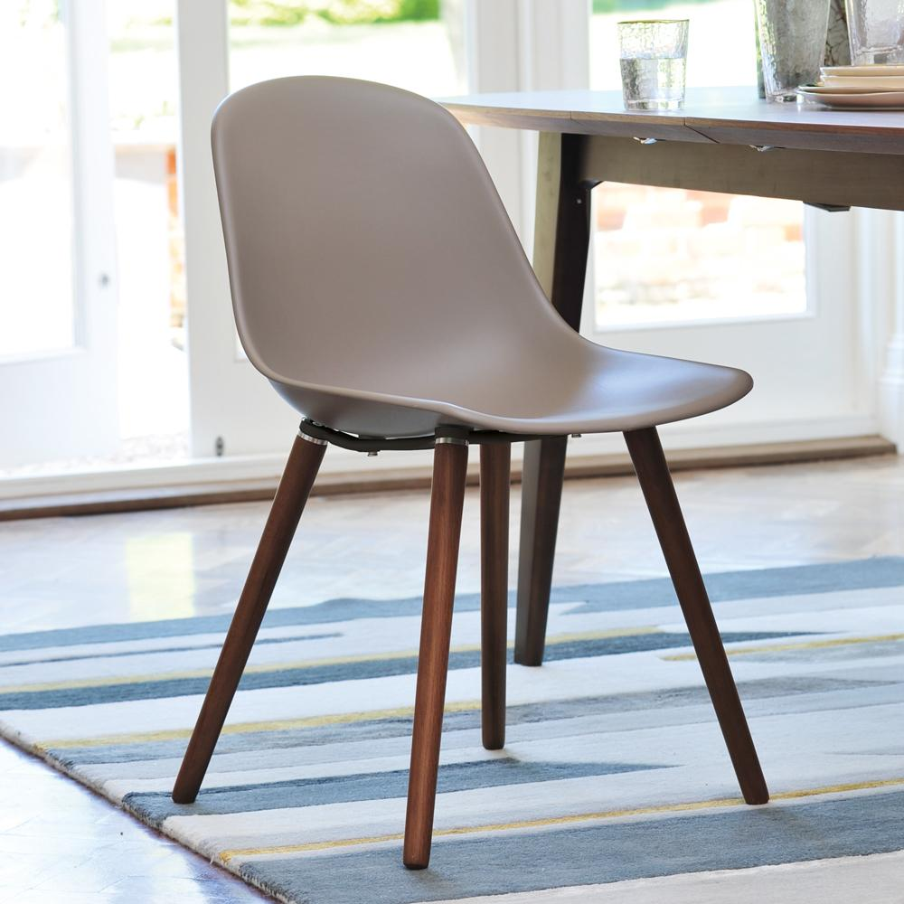 Plex dining chair with walnut leg stone
